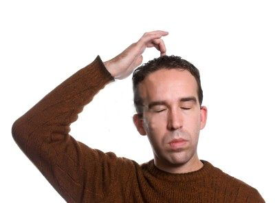 Man doing emotional-freedom-technique-by-tapping-on-the-top-of-his-head